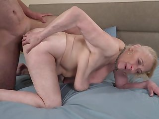 A big hairy dude is fucking a torrid venerable granny on the bed