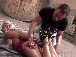 Gagged bdsm babe getting groped and spanked