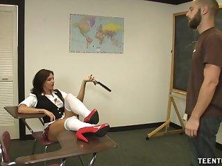 Kinky brunette teacher in miniskirt makes her student ejaculate