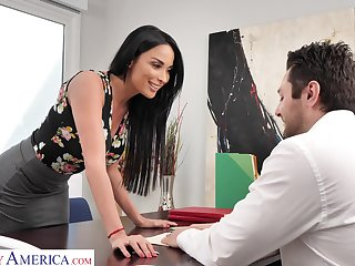 Femme fatale woman Anissa Kate offers himself sitting on the boss's table